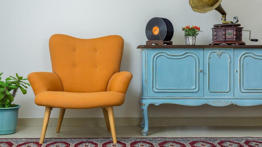 Retro armchair with antique sideboard