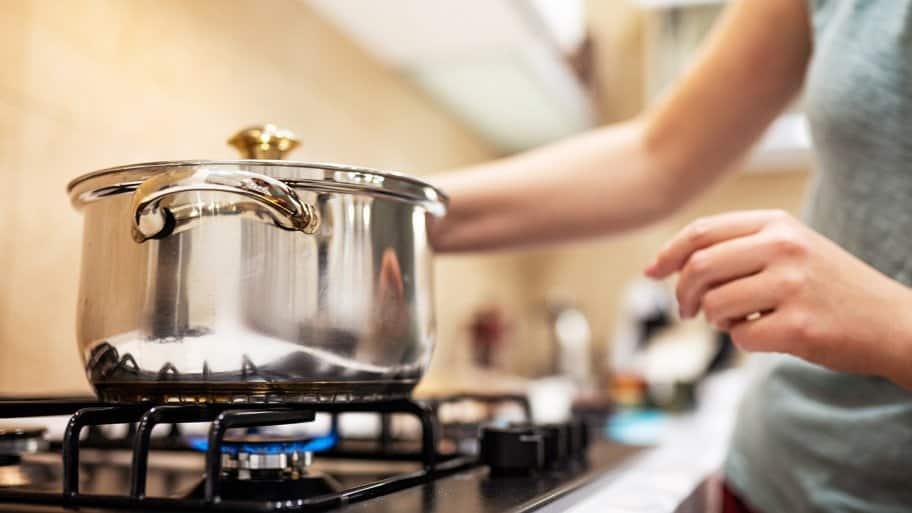 Preparing dinner on gas stove.