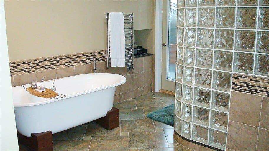 bathroom with glass block wall