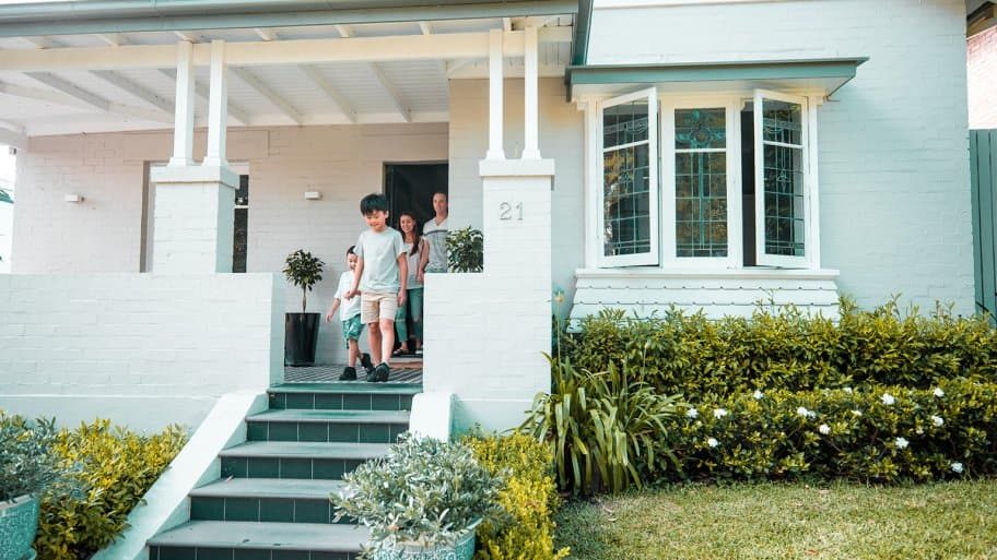 happy family walking out front door