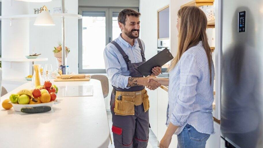 Contractor shaking hands with customer (Photo by ljubaphoto/ E+ via Getty Images)