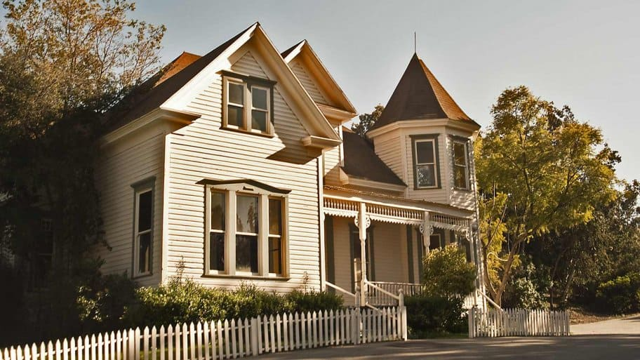 A historic home with picket fence