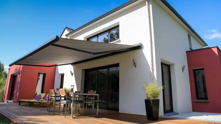 modern home backyard patio with awning