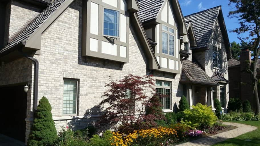 It doesn't have to cost a fortune to pull out shrubs or plants that are not thriving and replace them with new ones to beautify your landscape before selling, says Slavitz. (Photo courtesy of Angie's List member Tom G. of Chicago)