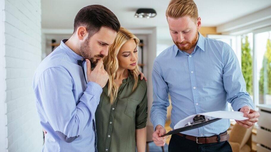 Homeowners looking over bid