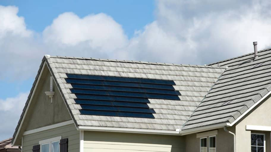 A house with solar shingles on its roof