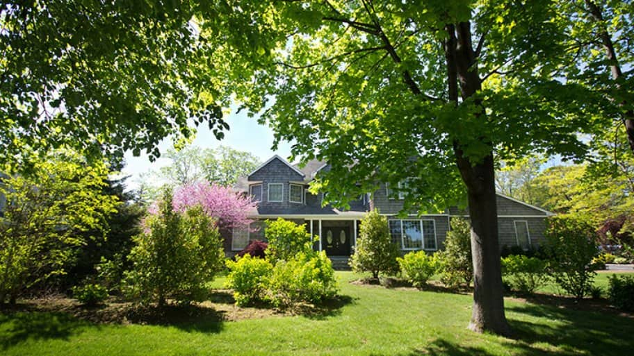 Home with beautiful trees and landscaping