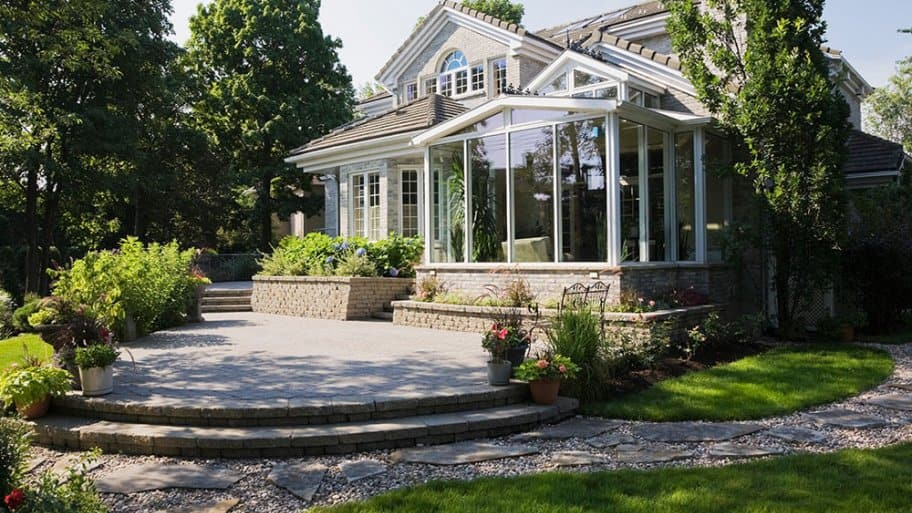 Beautiful home with stone patio and landscaping