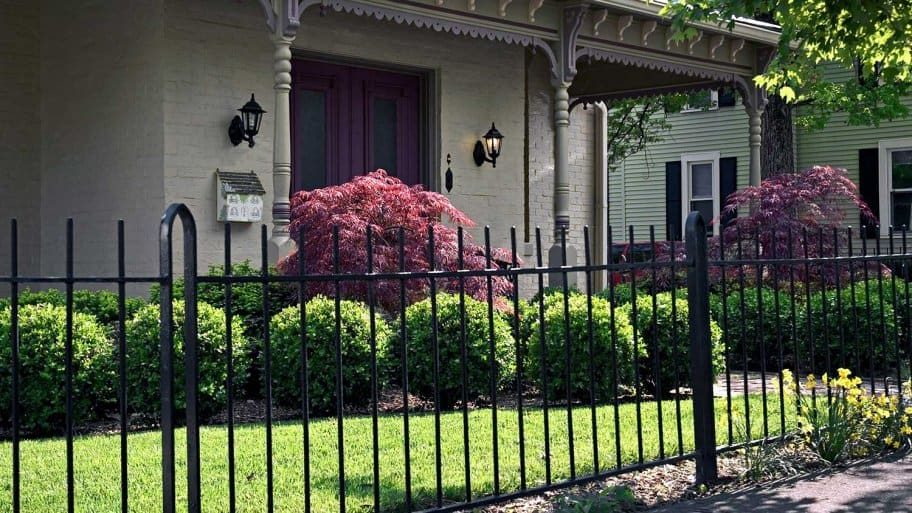 House with wrought iron fence