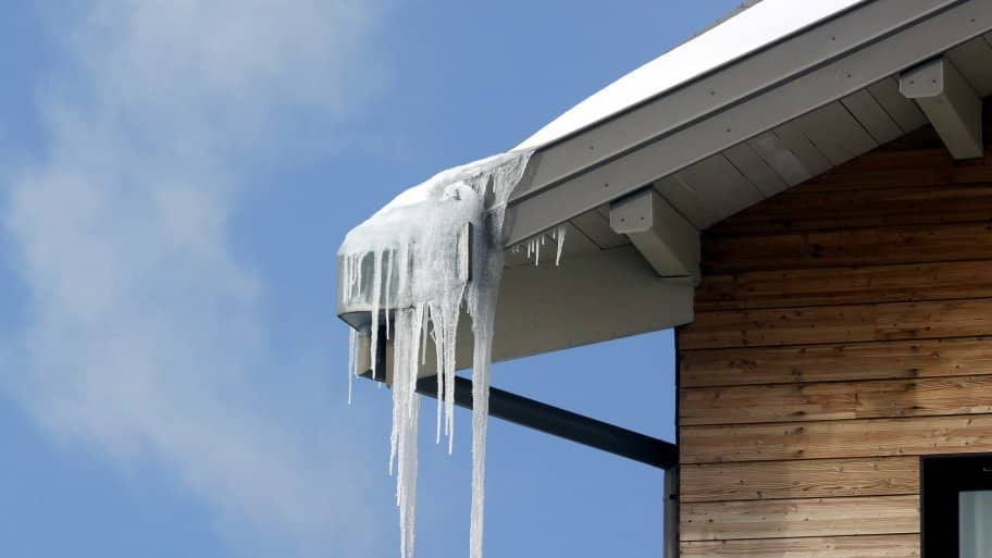 cluster of icicles hanging on gutter