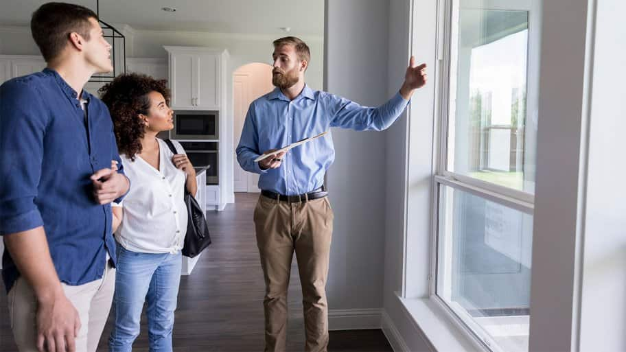 couple discussing windows with inspector
