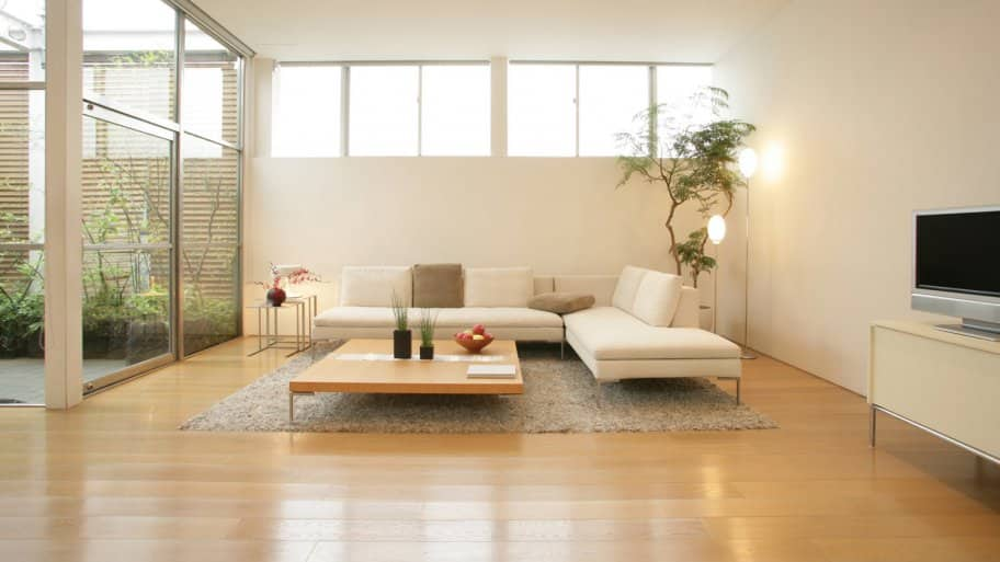 An interior of a living room with laminate flooring