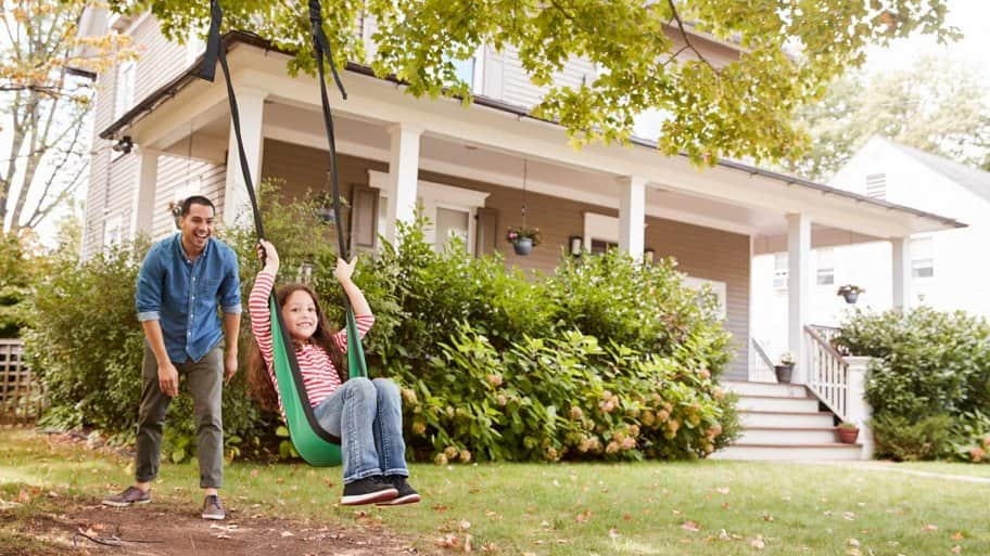 Father pushes daughter in swing