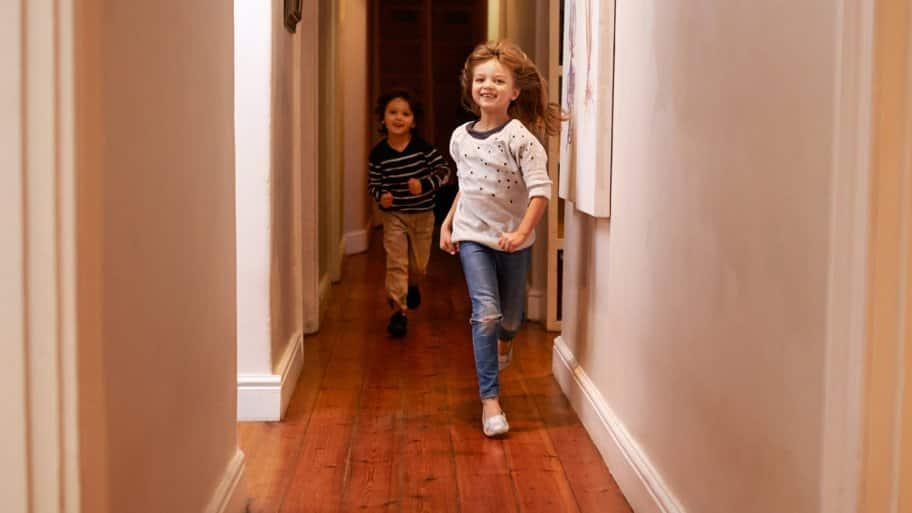 Kids running down hallway with wood floors