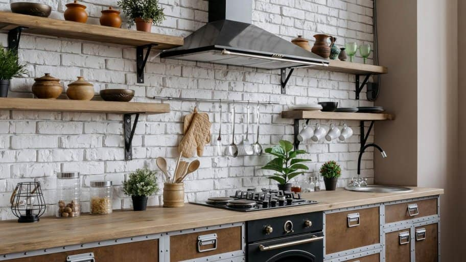 A kitchen interior with a range hood above the gas stove