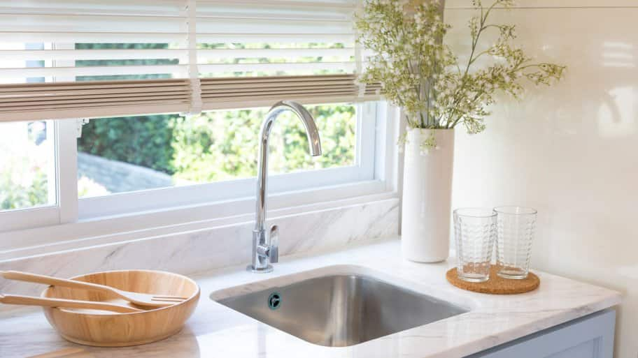 A luxurious kitchen sink in front of a window