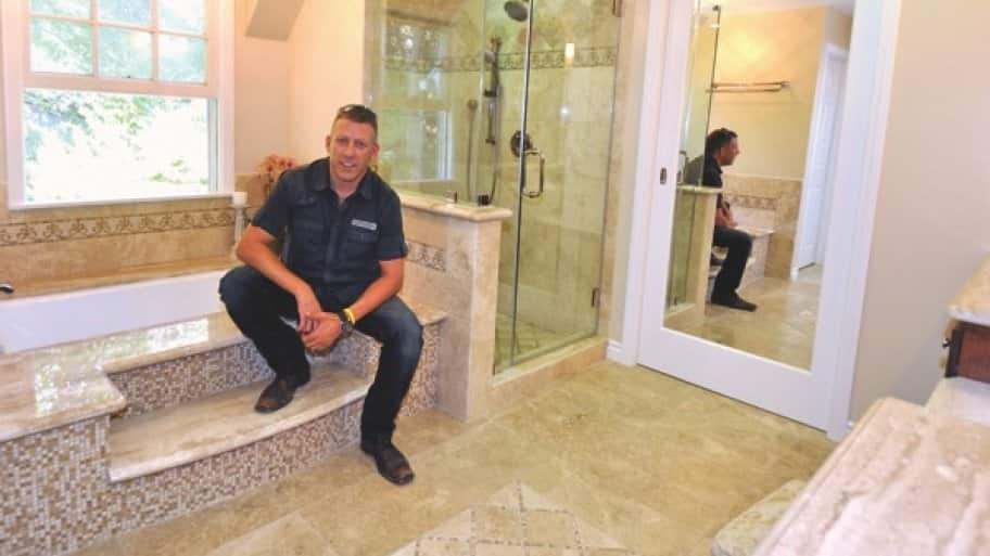 Company owner Avi Ben Dov shows off his remodeling handiwork. (Photo courtesy of Finesse Remodeling & Consulting)