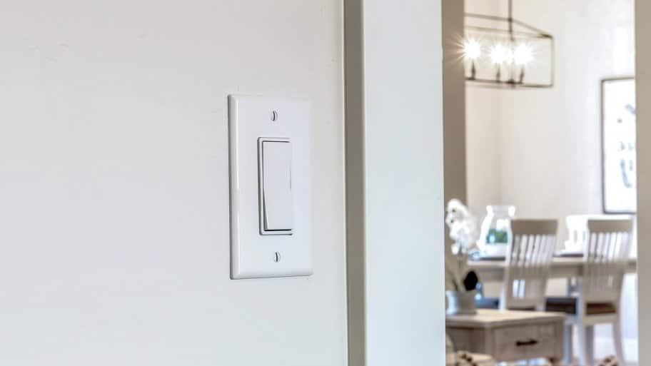 Light switch on wall (Photo by Jason - stock.adobe.com)