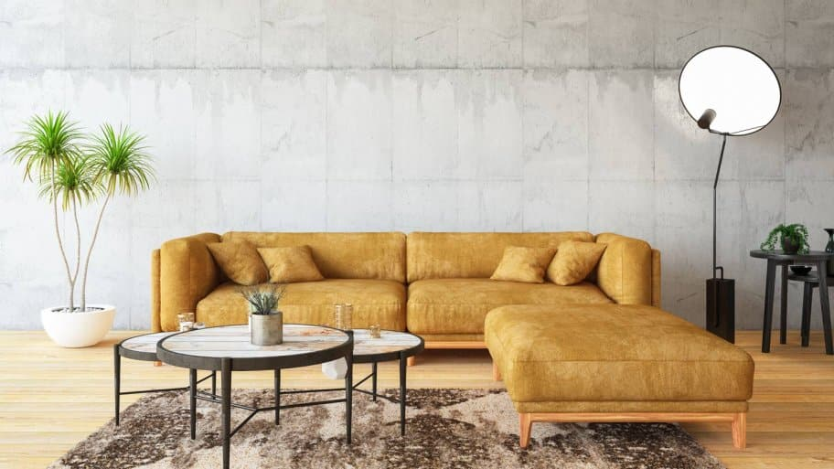 A living room with a yellow sofa