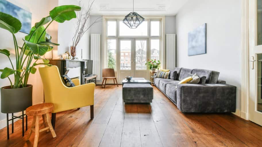 Living room with rustic wood flooring