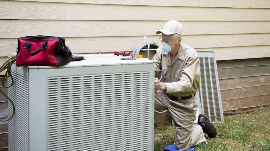 Man fixing air conditioner unite