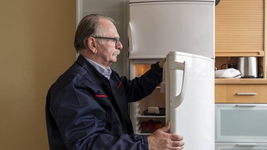 Man fixing refrigerator