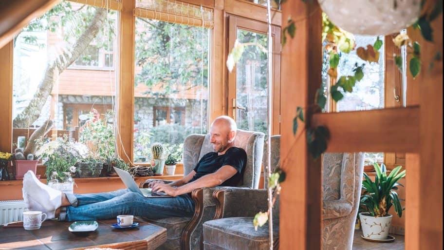 Man sits in sunroom