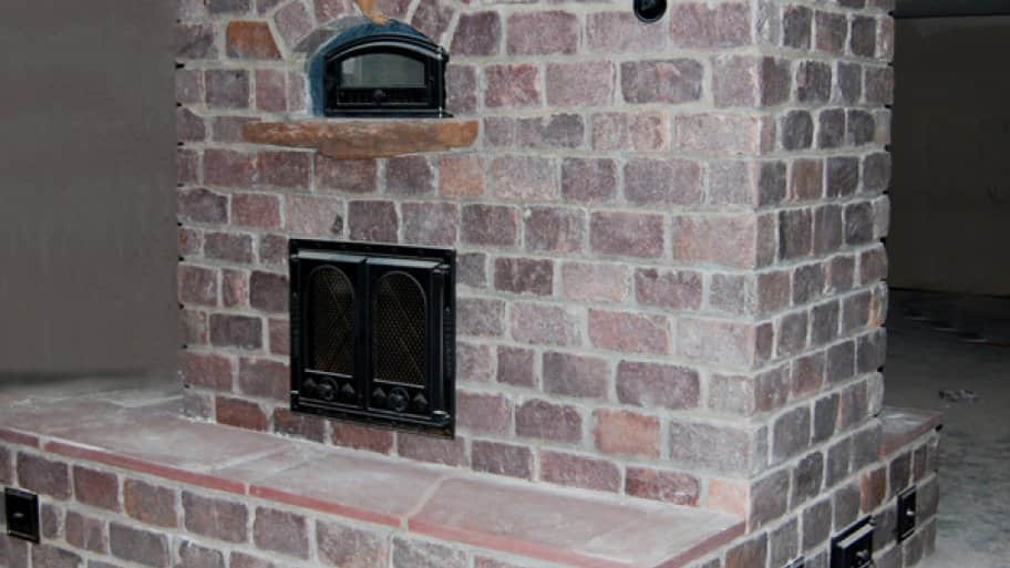 Masonry heaters burn very clean, with practically no emissions, making them an environmentally friendly choice, says Padgitt. (Photo courtesy of Hearthmasters, Inc.)