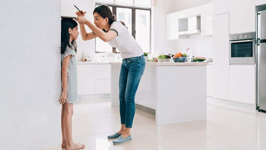 Measuring height of child on a big wall, open concept kitchen