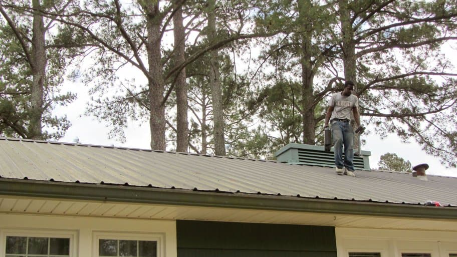 metal roofer working