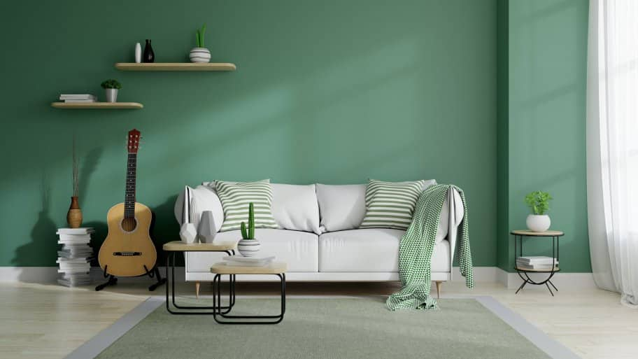 A bright minimalistic living room with a green wall