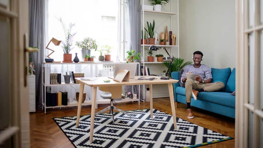 Person sitting on sofa in a small apartment room