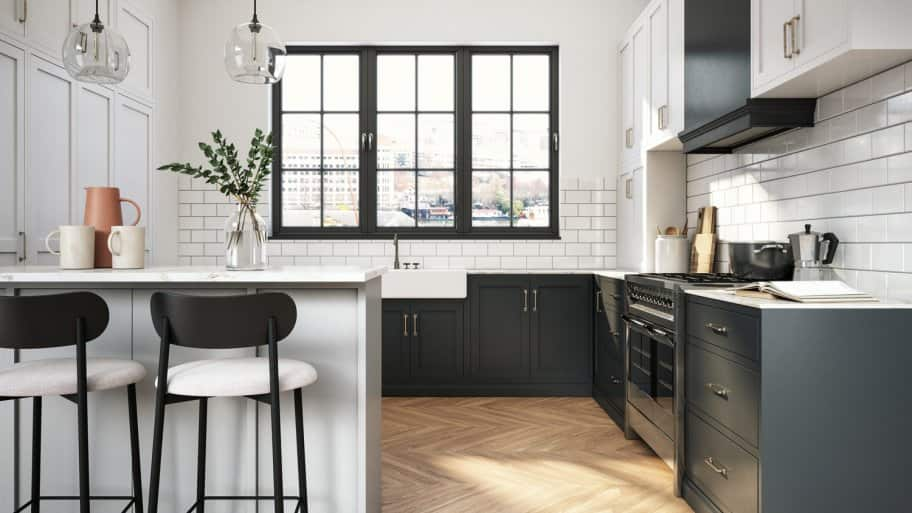 A modern kitchen with black and white cabinets