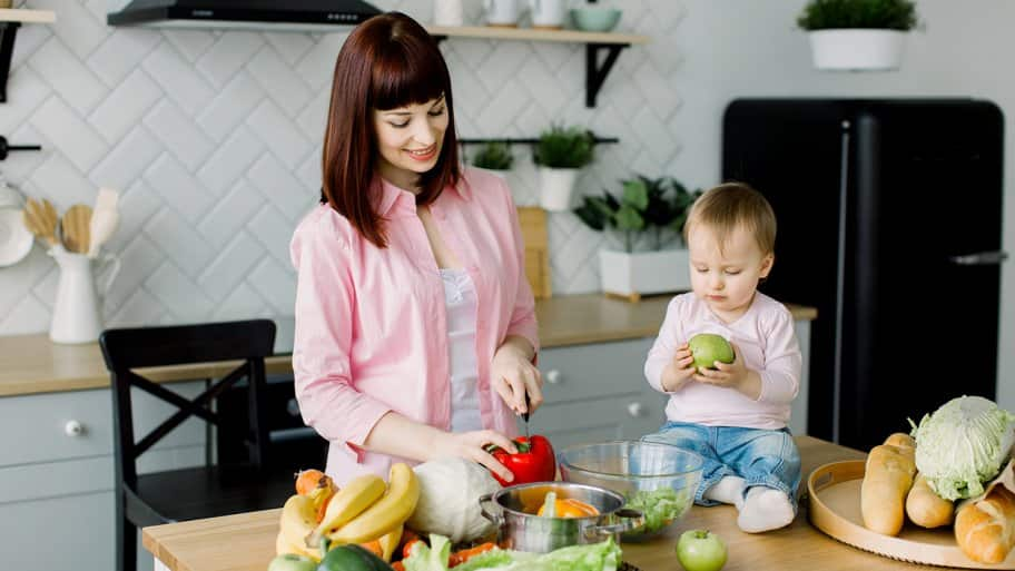 Mother and child cook in kitchen