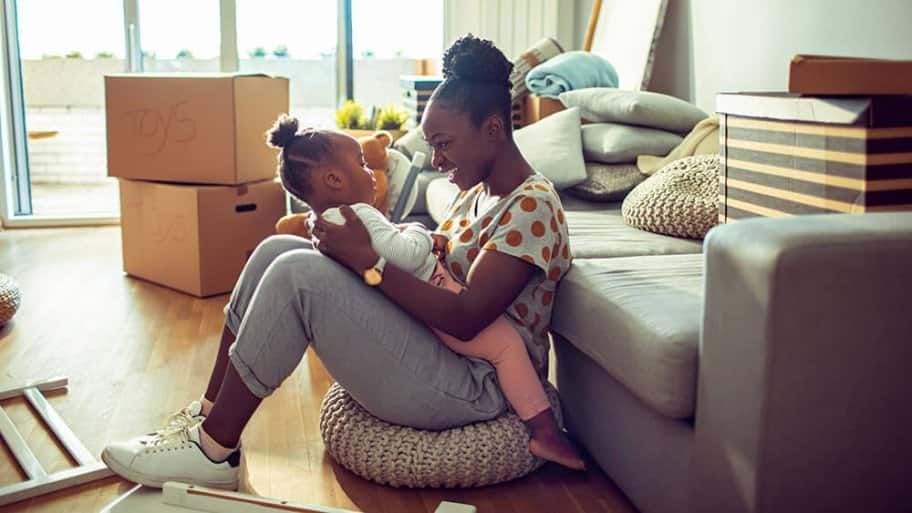 Mother playing with child while packing