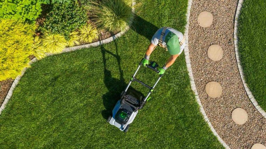 Aerial view of man mowing yard