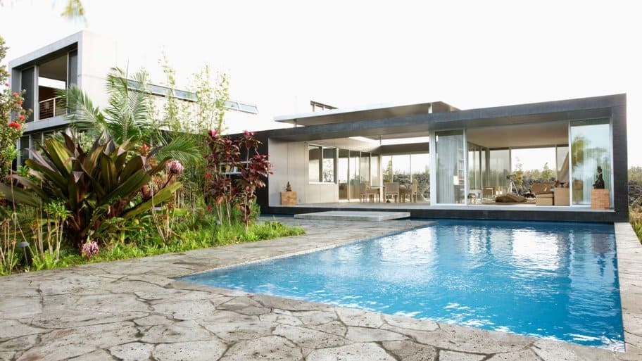 Natural stone patio with a modern house in the background