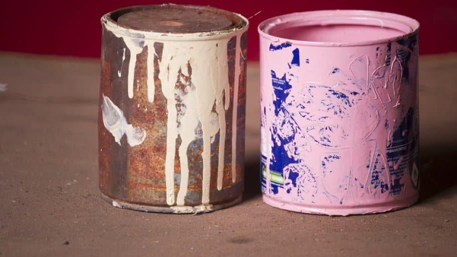 Old paint cans (Photo by Kypros / Moment via Getty Images)