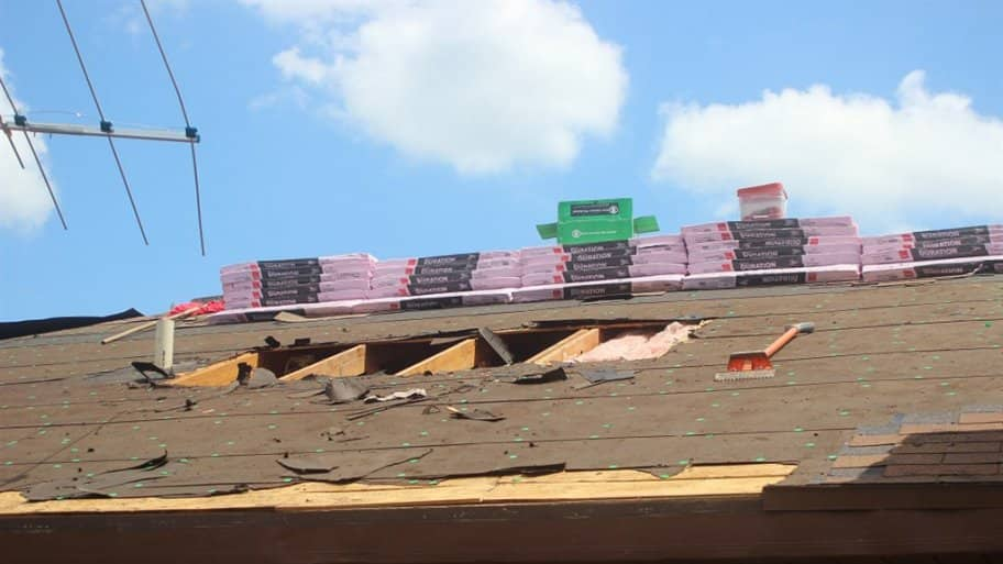 new roofing install on home exposed underlayment