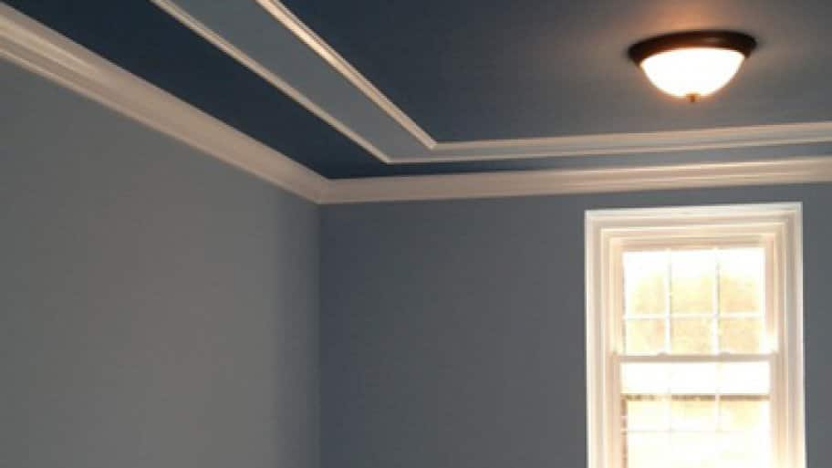 room and ceiling with molding painted different colors of blue