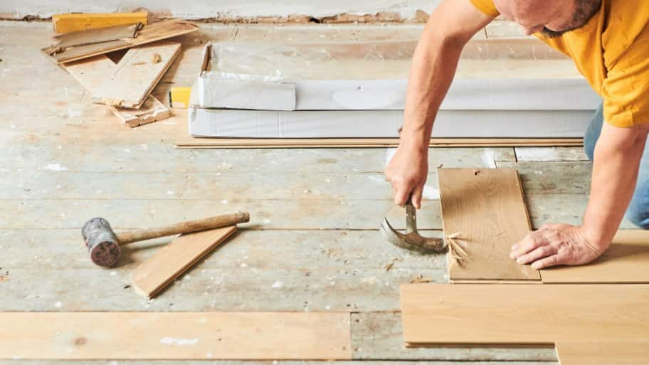Contractor laying new wood flooring (Photo by Keep It 100 / DigitalVision via Getty Images)