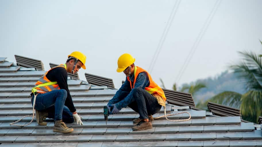A professional workers installing a tile roof (Photo by Visoot Uthairam/Moment via Getty Images)