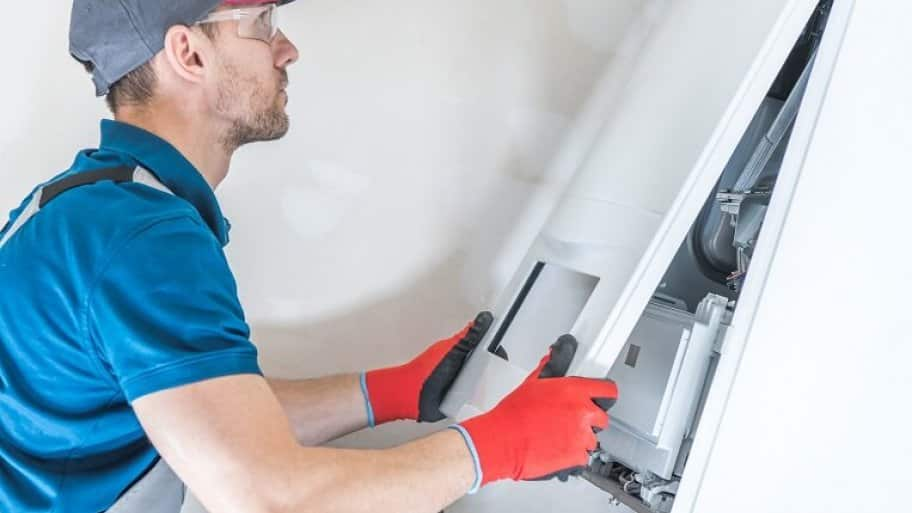 professional cleaning a furnace