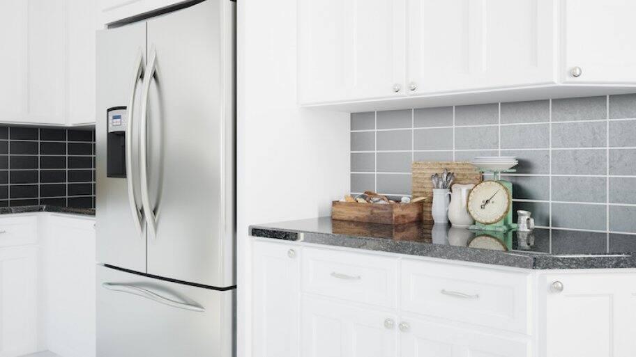 a silver refrigerator in a modern kitchen
