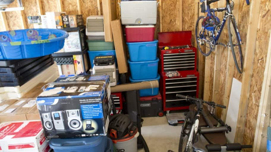 Garage filled with a bike, boxes and other items