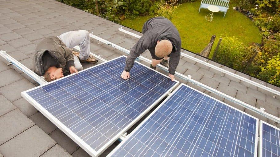 Men repairing a solar panel