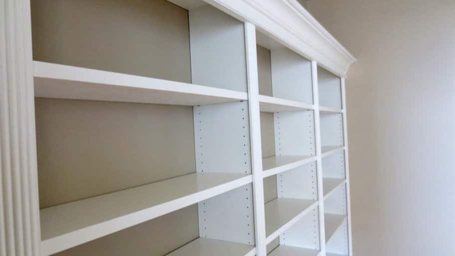 white built-in bookshelves