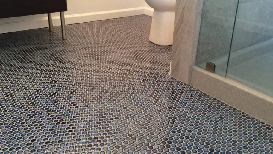 floor covered in blue penny tile