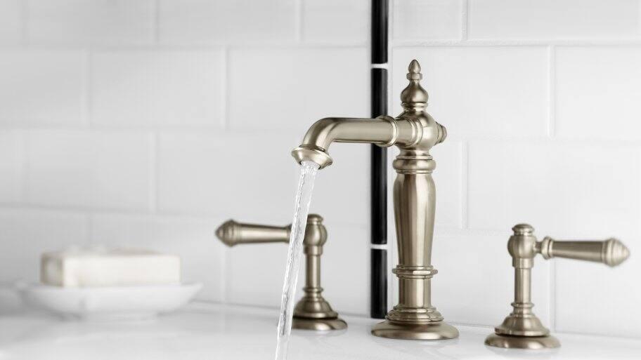 Kohler faucet running in bathroom