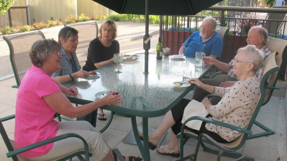 seniors seated at patio table